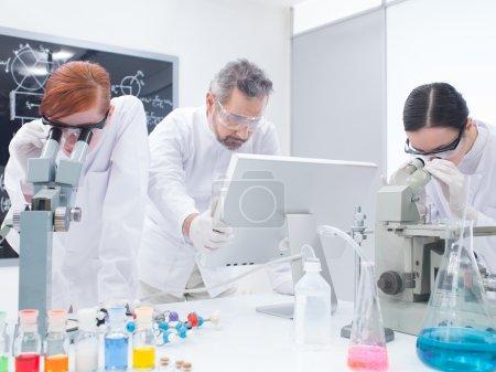 student under microscope analysis