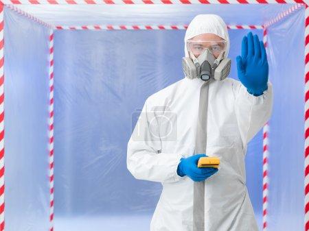 Person in biohazard suit calling a halt