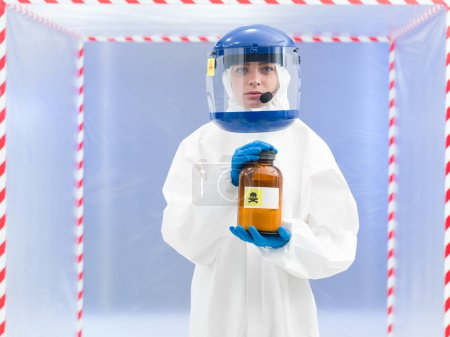 Person in a biohazard suit with a toxic substance