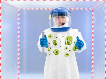 technician in protective suit holding biological sample