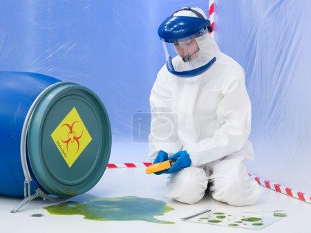 specialist measuring level of contamination
