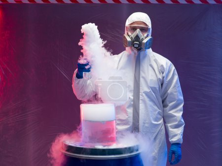 chemist experimenting with vapors on blue barrel