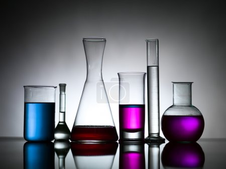 Different lab bottles filled with colored substances