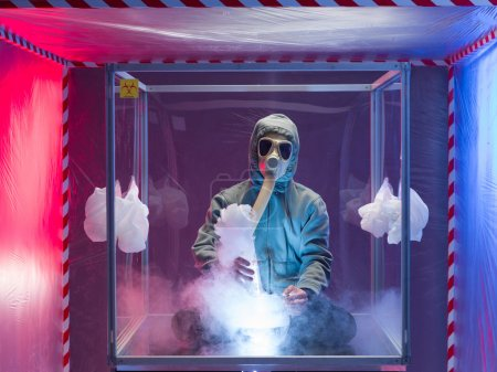 person experimenting inside protection enclosure