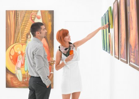 artist showing work in art gallery