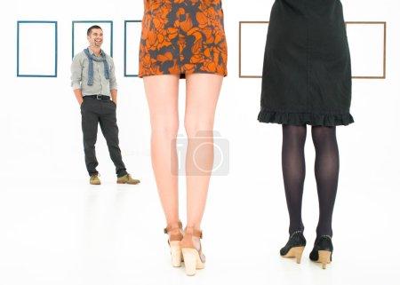 back view of women legs in art gallery