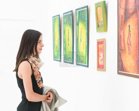 woman admiring colorful painting