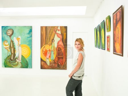 young woman visiting art exhibition