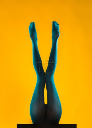 Woman legs wearing blue pantyhose