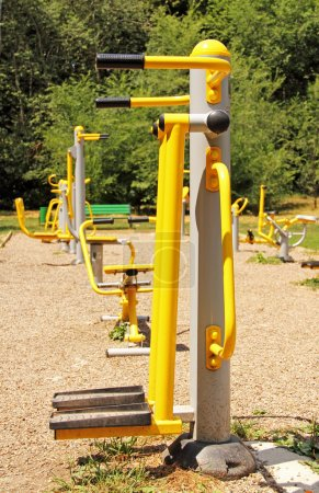 Playground in a city park. Fitness equipment available.