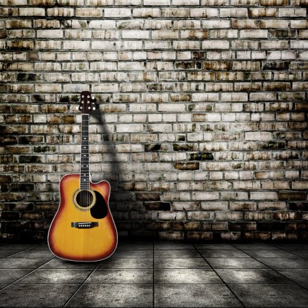 Photo for Guitar in blank empty room with brick wall background - Royalty Free Image