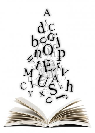 Photo pour Livre ouvert avec des lettres tombant sur fond blanc - image libre de droit