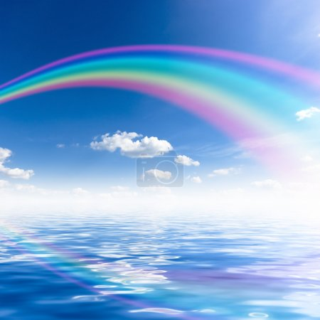 Photo for Blue sky background with rainbow and reflection in water - Royalty Free Image