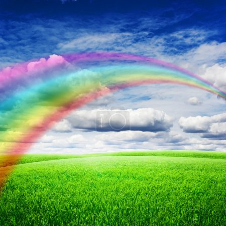 Photo for Green field under blue clouds sky with bright rainbow. Beauty nature background - Royalty Free Image