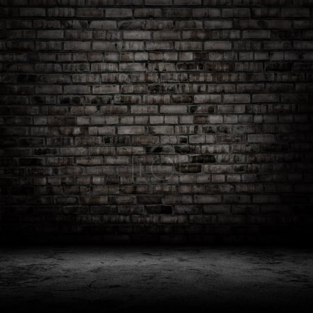 Dark room with tile floor and brick wall backgroun...
