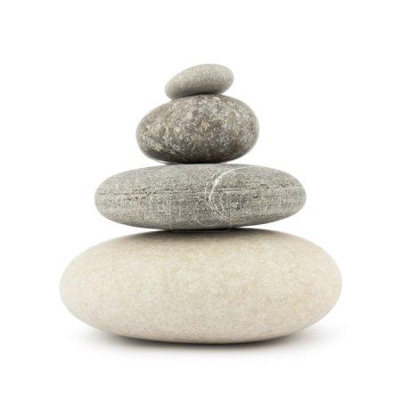 Photo pour Pile de pierres isolées sur blanc - image libre de droit