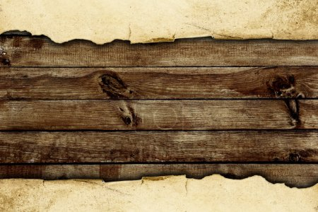 Photo for Torn paper over the wooden background - Royalty Free Image