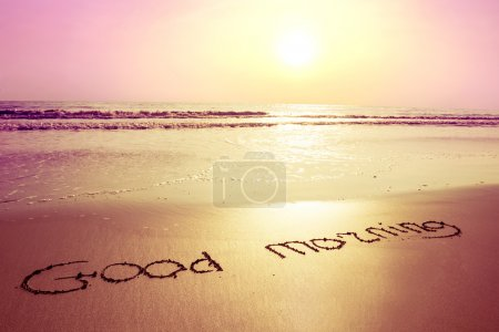 Photo for Sunrise,beach,sea coastline and sign on sand good morning. Beauty nature background - Royalty Free Image