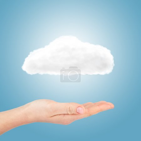 Photo for Cloud in hand on blue background - Royalty Free Image