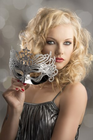 blonde girl with silver mask turned of three quarters