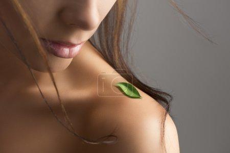naked shoulder with leaf and flying hair