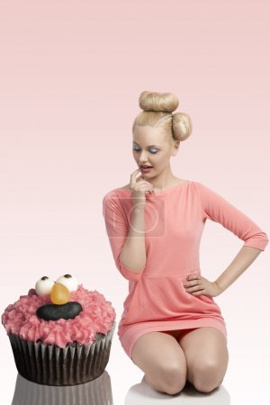 funny portrait of woman with big cupcake