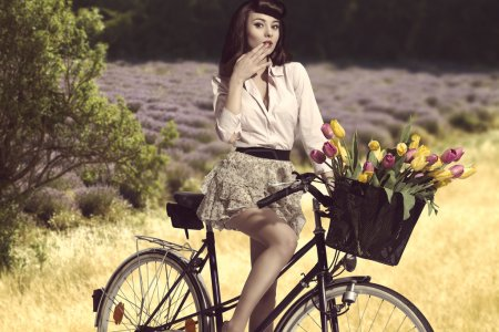Sexy brunette girl on bicycle in rural outdoor