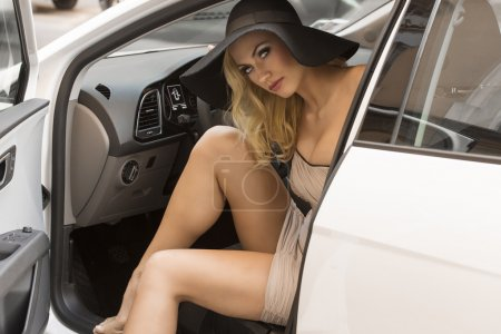 Sexy blond girl in car
