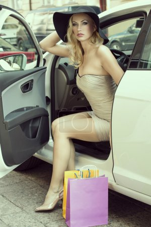blond sexy lady get out from car