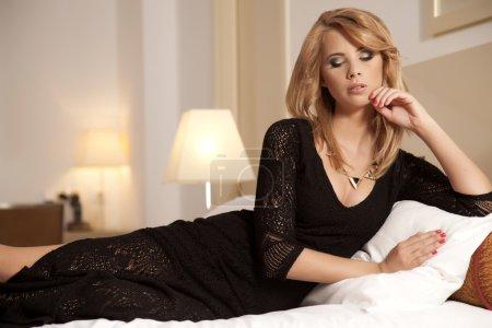 Beautiful and sexy woman wearing elegance dress