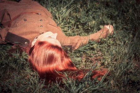 Young woman in Red Army form of 1943 year lying on...