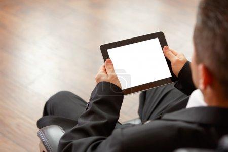 Photo pour Tablette numérique de business man holding - image libre de droit