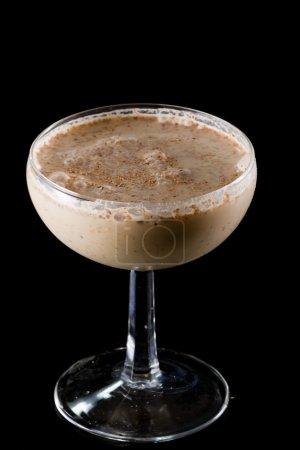 Brandy alexander served in a bowl over a black bac...