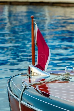 Vintage boats adorned with shiny chrome moored and ready to show.