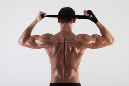 The muscular male back on white background