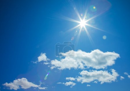 Star-shaped sun in blue sky