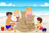 Family building sand castle
