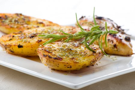 Serving of delicious crispy rosemary potatoes