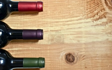 Photo for Wine bottle on a wooden table - Royalty Free Image