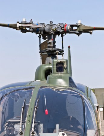 Close up front view of a military helicopter rotor hub and blades
