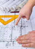 Architect rolls and plans blueprints planning interiors design construction real estate