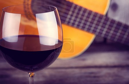 Photo for Guitar and Wine on a wooden table - Royalty Free Image