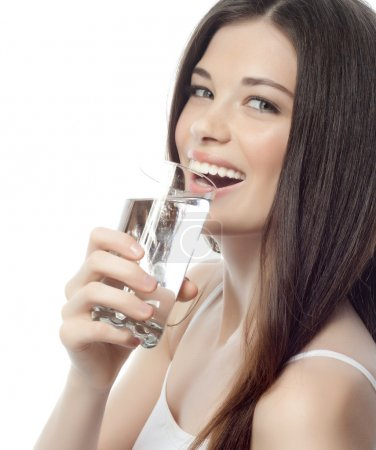 Smiling woman with glass of water