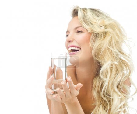 Photo for Portrait of attractive caucasian smiling woman isolated on white studio shot drinking water - Royalty Free Image