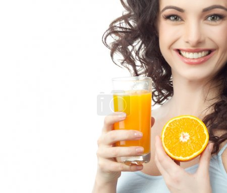 Smiling woman is drinking juice
