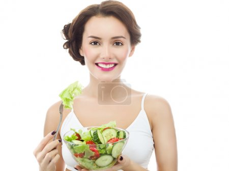 Photo for Portrait of attractive caucasian smiling woman is eating salat isolated on white. Studio shot - Royalty Free Image