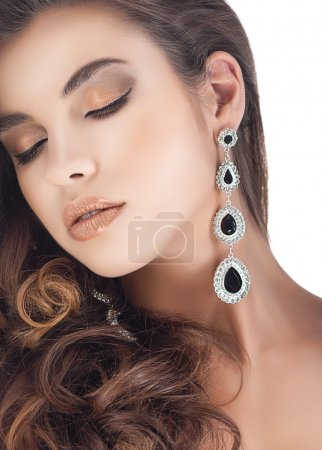 Woman with jewelry earrings