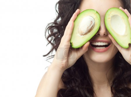 Photo for Portrait of attractive caucasian smiling woman isolated on white. Studio shot with avocado - Royalty Free Image