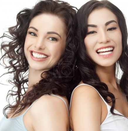 Photo for Portrait of two attractive caucasian and asian smiling women isolated on white studio shot - Royalty Free Image