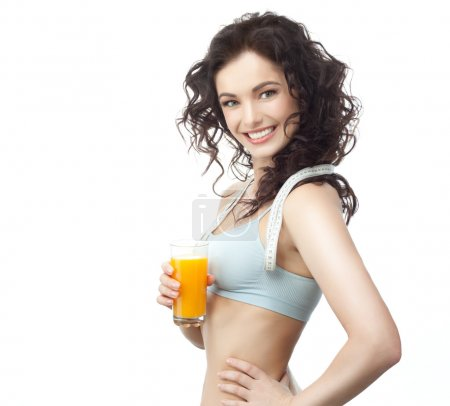 Photo for Head and shoulders portrait of attractive caucasian smiling woman with measuring tape is drinking orange juice isolated on white. Studio shot - Royalty Free Image